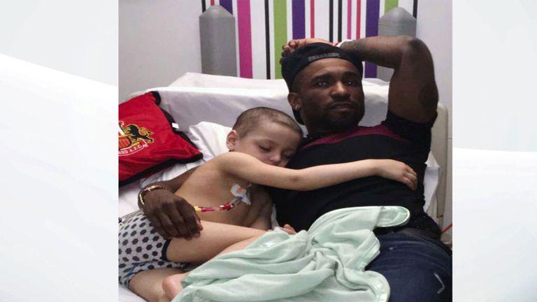 Bradley falls asleep next to his hero and best friend, Jermain Defoe