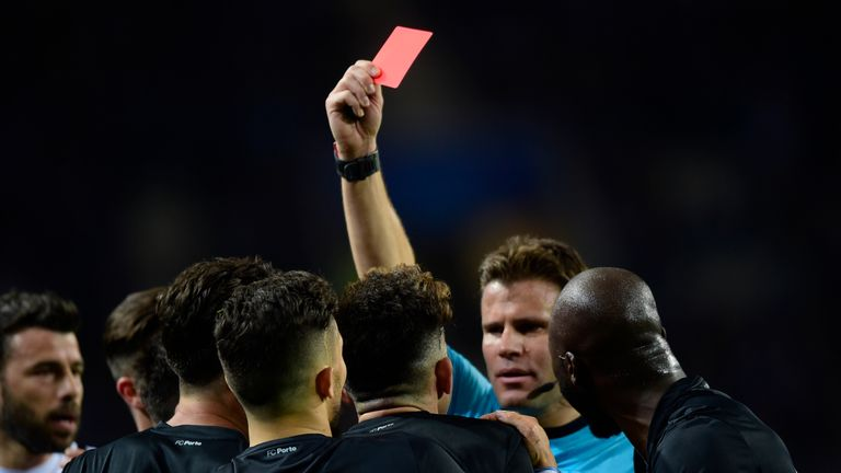 Referee Felix Brych sends off Porto defender Alex Telles in the first leg