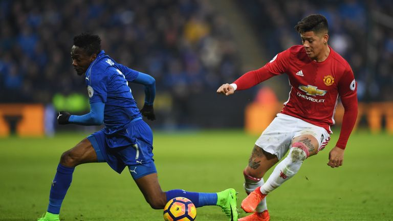 Marcos Rojo (right) and Ahmed Musa tussle at the King Power