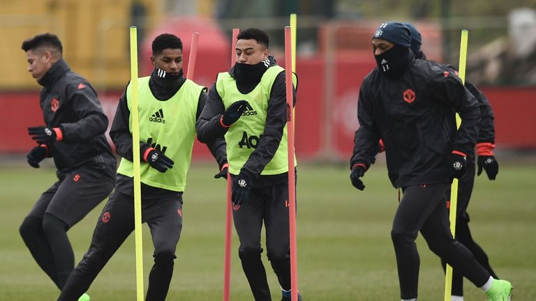 Marcos Rojo (far left) took part in Wednesday's session, having missed the weekend win over Watford