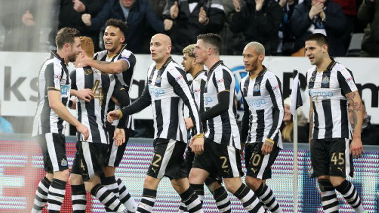 Newcastle players celebrate after an own goal by Aston Villa's Henri Lansbury put them 2-0 up at St. James' Park
