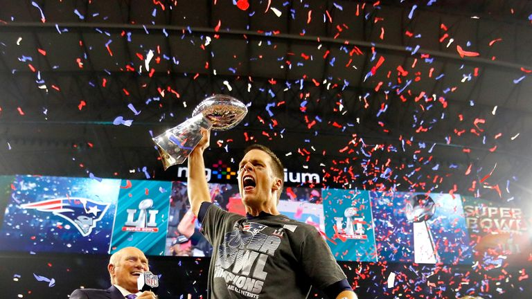 Tom Brady celebrates with the Vince Lombardi Trophy after defeating Atlanta in the Super Bowl