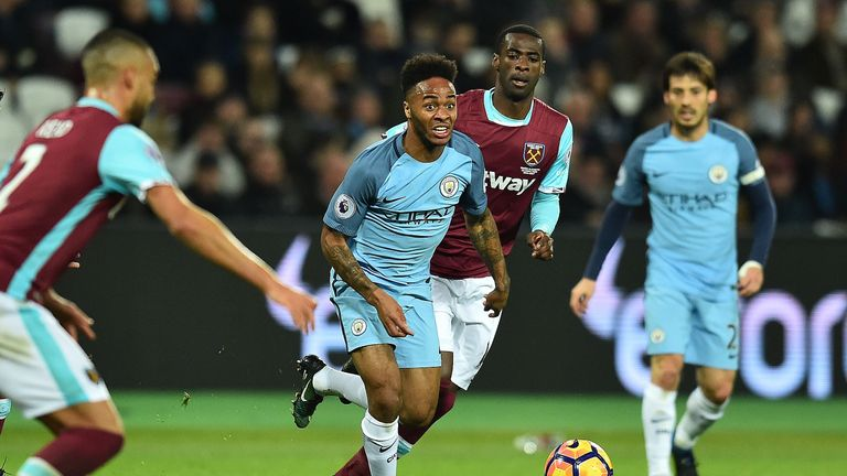 Raheem Sterling looks to escape the attention of West Ham defenders