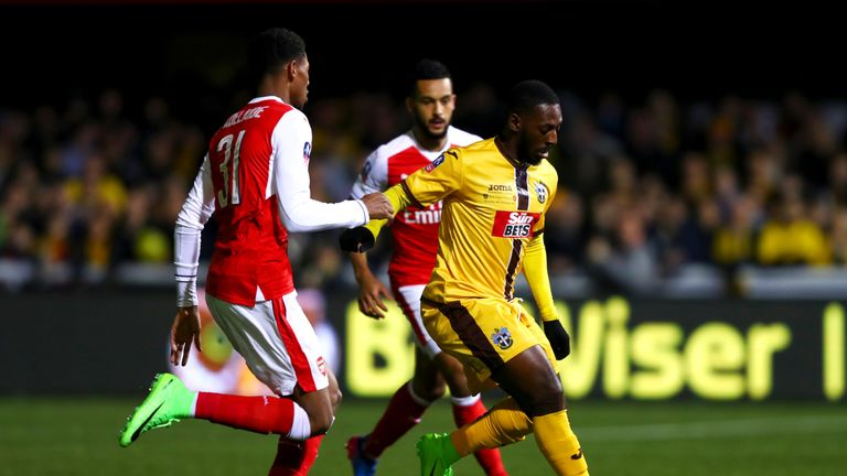 Roarie Deacon is put under pressure by Jeff Reine-Adelaide