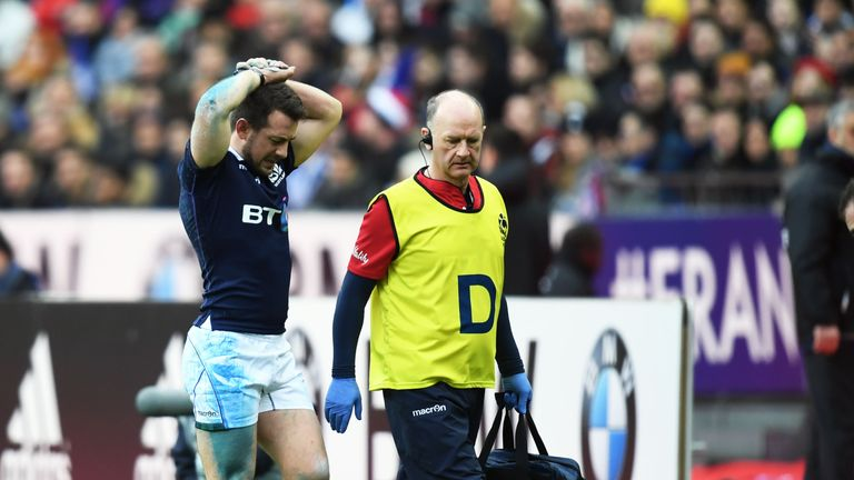 Greig Laidlaw leaves the pitch injured against France