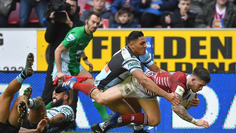 Burgess hat-trick leads Wigan to World Club title