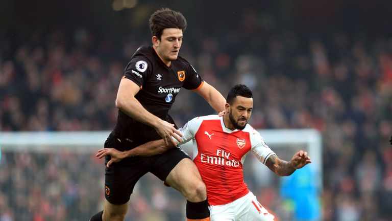 Theo Walcott tries to get away from Harry Maguire
