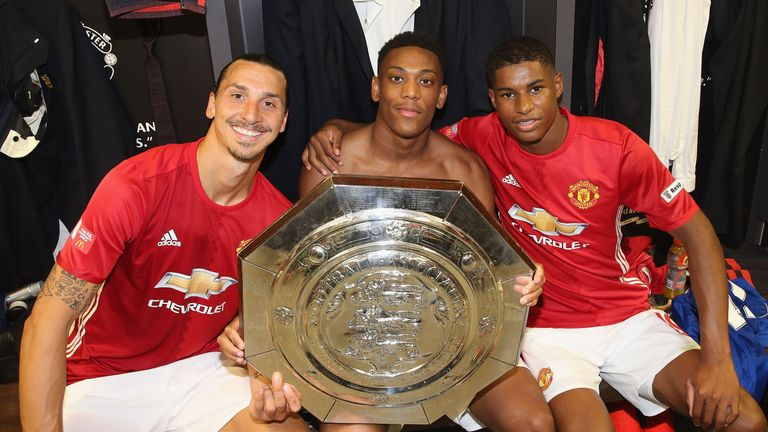 Ibrahimovic (L), Anthony Martial (C) and Rashford (L) with the Community Shiedl