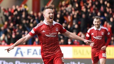 Aberdeen's Adam Rooney celebrates his goal against Ross County