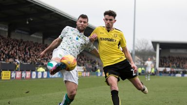 Yanic Wildschut (left) and Tom Flanagan compete for the ball