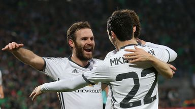 Henrikh Mkhitaryan (R) celebrates his goal at St Etienne with team-mates