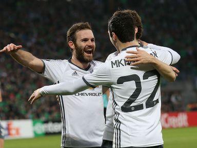 Henrikh Mkhitaryan (R) celebrates his goal with team-mates
