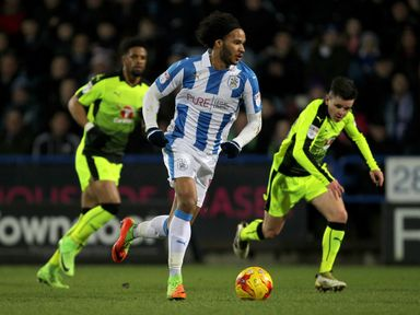 Huddersfield Town's Isaiah Brown turns and sprints away from Reading's Liam Kelly