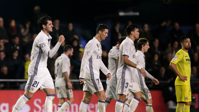 Real Madrid's forward, Alvaro Morata (L), celebrates after scoring the winner against Villarreal