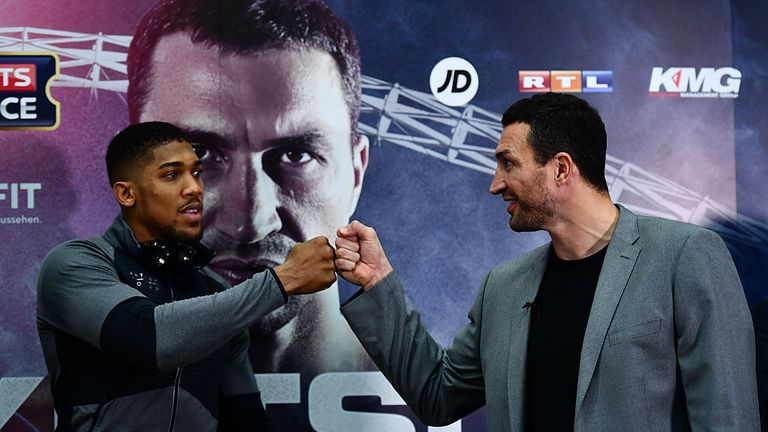 LONDON, ENGLAND - DECEMBER 14:  Wladimir Klitschko of Ukraine (r) greets Anthony Joshua of Great Britain during a press conference at Wembley Stadium