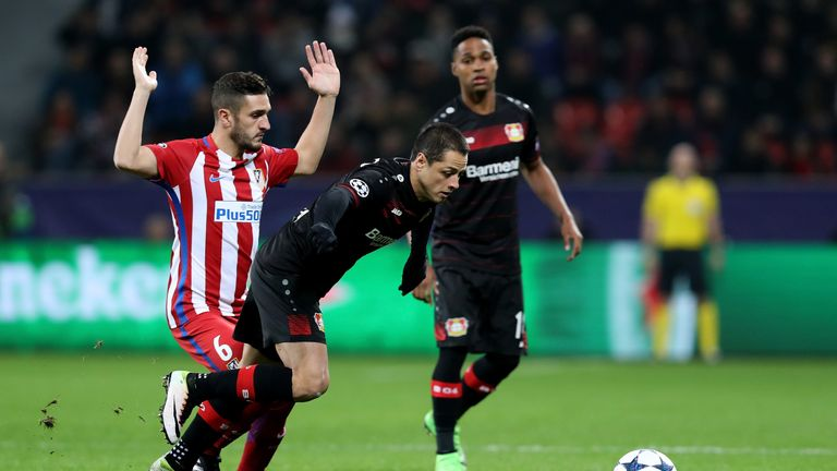 (L) of Leverkusen and of Atletico battle for the ball during the UEFA Champions League Round of 16 first leg match between Bayer Leverkusen an