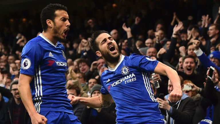 Chelsea's Spanish midfielder Cesc Fabregas (R) and Chelsea's Spanish midfielder Pedro (L) celebrate after Fabregas scored the opening goal during the Engli