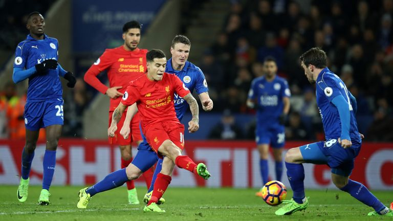 LEICESTER, ENGLAND - FEBRUARY 27:  Philippe Coutinho of Liverpool scores his sides first goal during the Premier League match between Leicester City and Li
