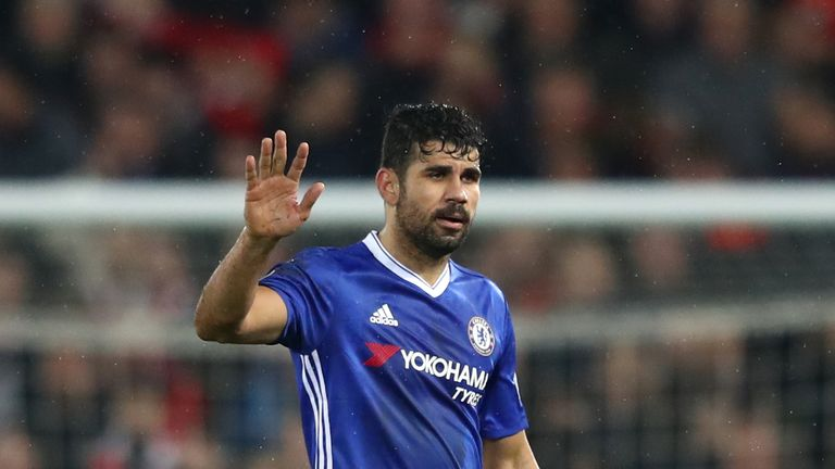 Diego Costa of Chelsea waves to fans after the Premier League match between Liverpool and Chelsea at Anfield on January 31