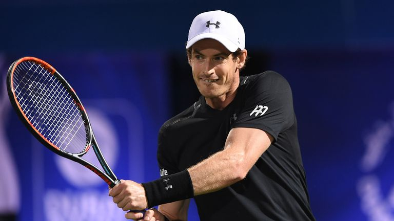 Andy Murray returns a shot during his match against Malek Jaziri