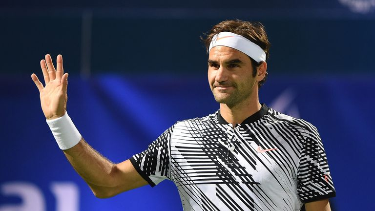 Roger Federer salutes the crowds during his match against Benoit Paire