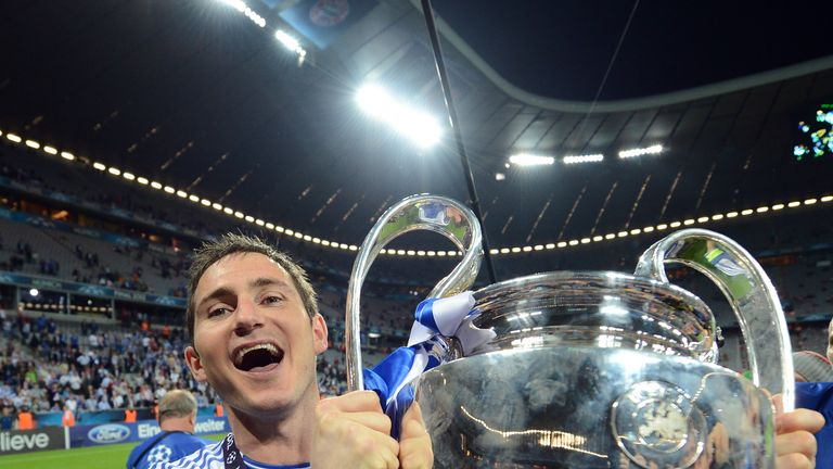 Frank Lampard celebrates with the Champions League trophy after defeating Bayern Munich on penalities