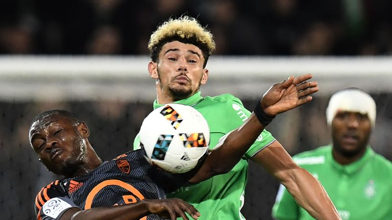 Abdul Waris Majeed and Kevin Malcuit (R) vie for possession during a French Ligue 1 match