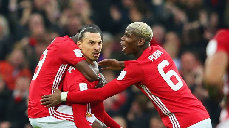 Zlatan Ibrahimovic celebrates his goal with team-mates Eric Bailly (L) and Paul Pogba