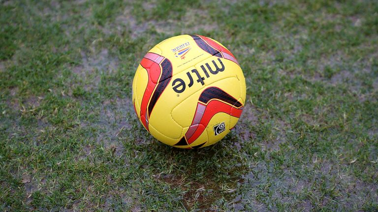 A matchball sits in a puddle