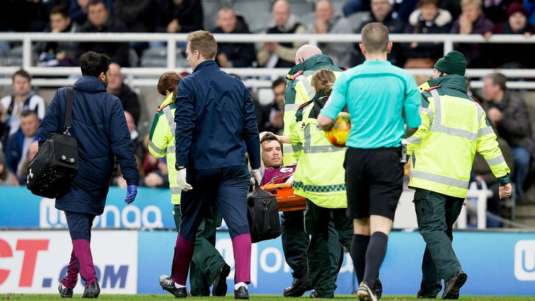 Scott Hogan leaves the pitch on a stretcher after suffering an injury during the Championship match at St James' Park