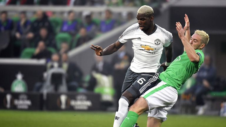 Jordan Veretout vies for possession with Paul Pogba at the Geoffroy Guichard stadium