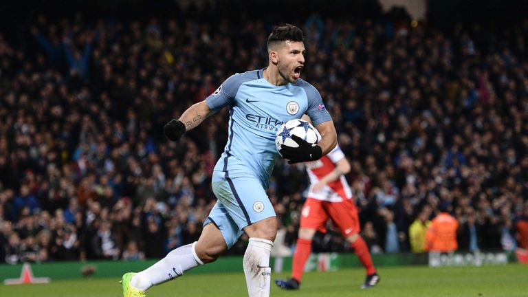 Manchester City's Argentinian striker Sergio Aguero celebrates scoring their second goal during the UEFA Champions League Round of 16 first-leg football ma