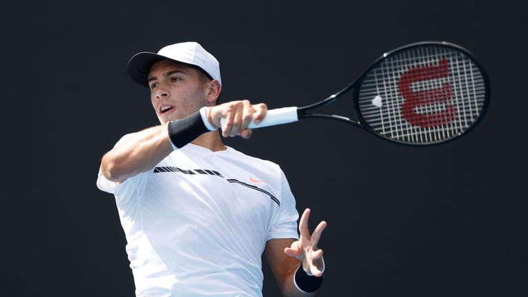 Borna Coric of Croatia plays a forehand in his first round match against Alexandr Dolgopolov of Ukraine