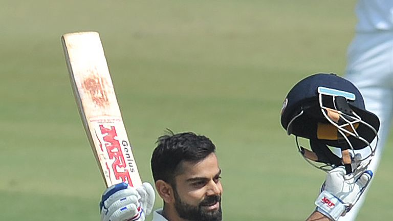 India's captain Virat Kohli raise his bat after scoring double century(200 runs) plays a shot on the second day of the only Test match between India and Ba
