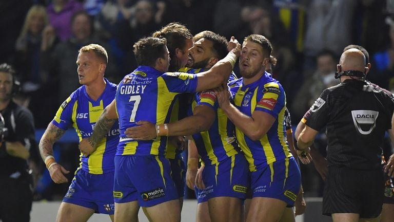 Warrington Wolves' Ryan Atkins is congratulated on scoring his team's 2nd try during the 2017 Dacia World Club Series match at the Halliwell Jones Stadium,