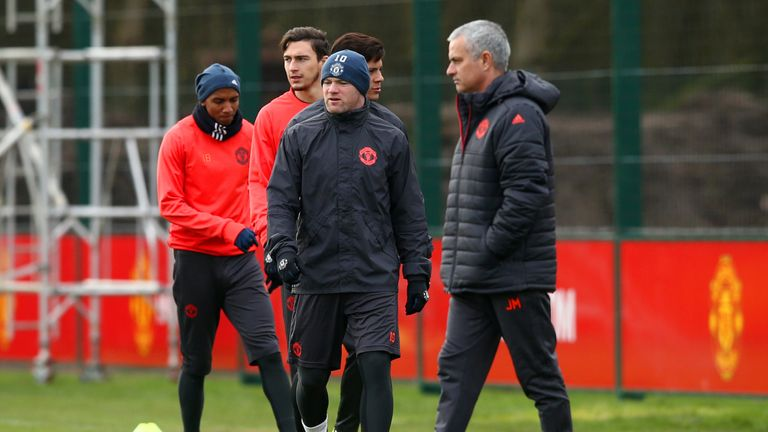 MANCHESTER, ENGLAND - FEBRUARY 21:  Jose Mourinho, manager of Manchester United walks past Wayne Rooney during a training session ahead of the UEFA Europa