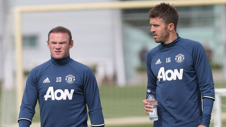 MANCHESTER, ENGLAND - AUGUST 05:  Wayne Rooney and Michael Carrick of Manchester United in action during a first team training session at Aon Training Comp