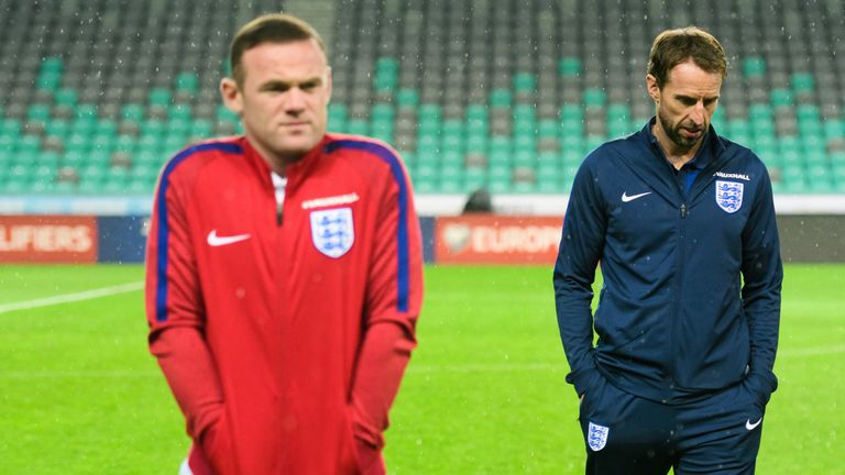 Southgate and Wayne Rooney earlier this season