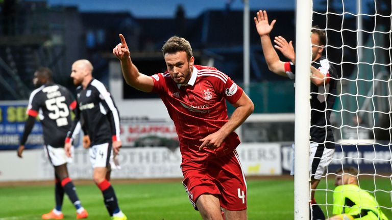 Aberdeen's Andrew Considine celebrates after scoring the opening goal