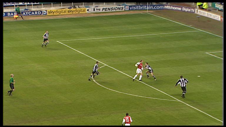 Bergkamp flicks the ball around Newcastle's Nikos Dabizas