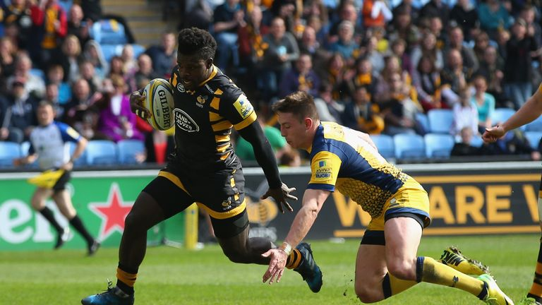 Christian Wade beats a tackle from Josh Adams on his way to scoring for Wasps