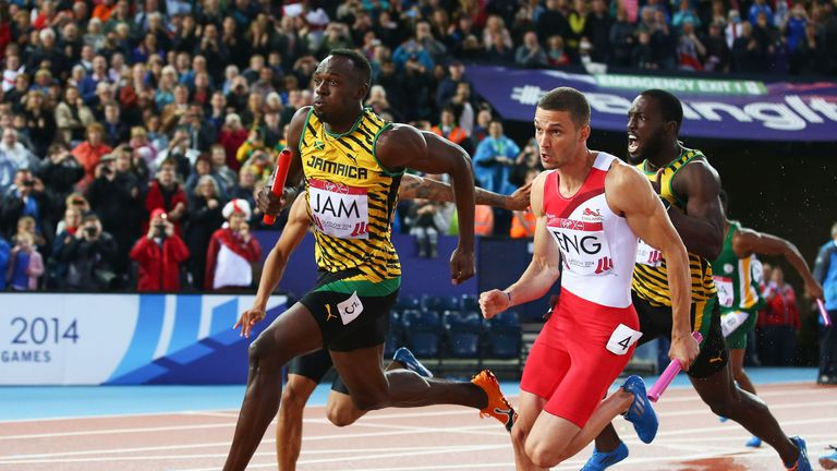 Usain Bolt competing in the 4x100m relay final at the 2014 Commonwealth Games