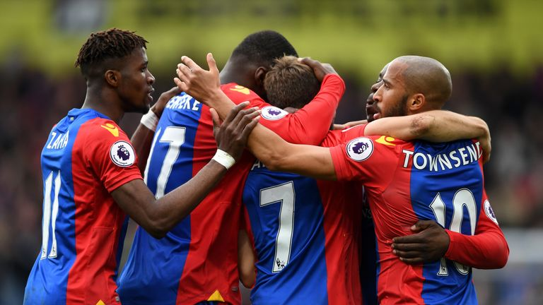 Yohan Cabaye (middle) celebrates with his team-mates