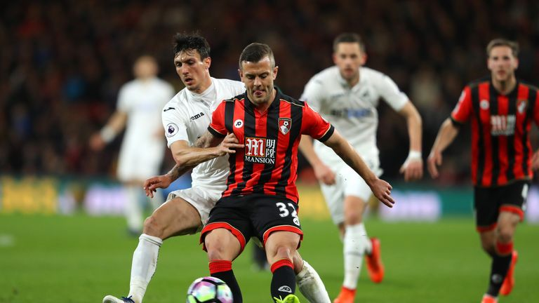 Jack Cork of Swansea City (left) and Bournemouth midfielder Jack Wilshere battle for possession