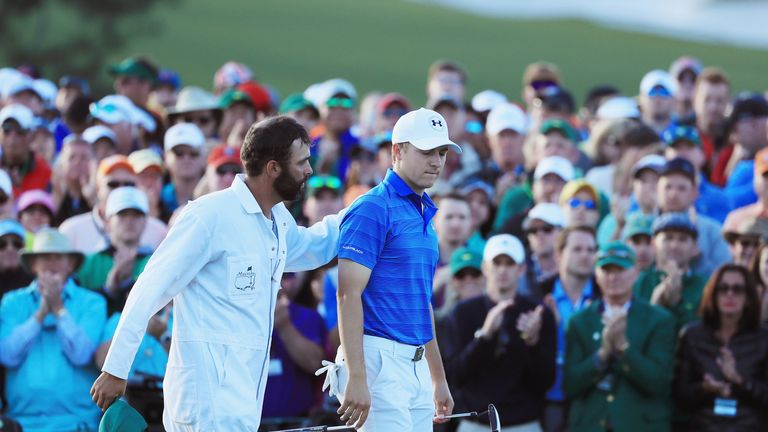 Jordan Spieth is consoled by caddy Michael Greller after his final-round Augusta swoon