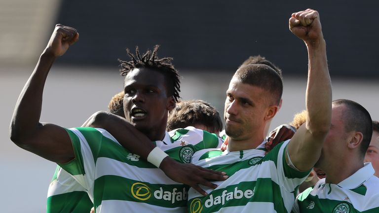 Celtic's Jozo Simunovic celebrates scoring his side's first goal of the game