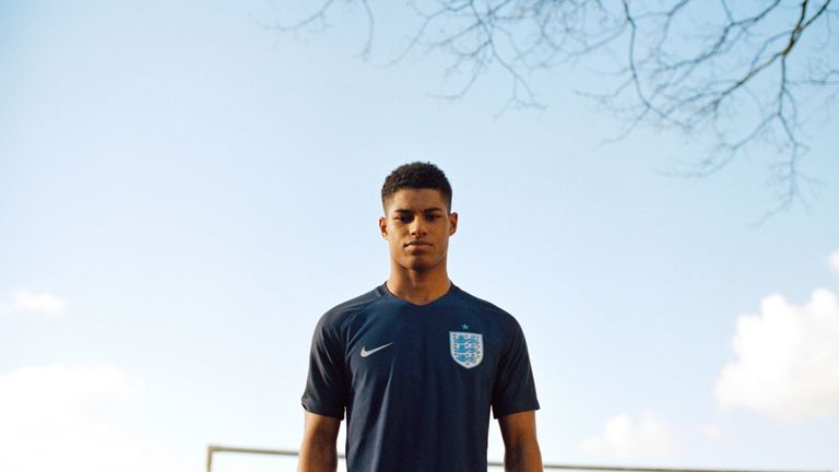 Manchester United's Rashford poses in the head-to-toe navy kit