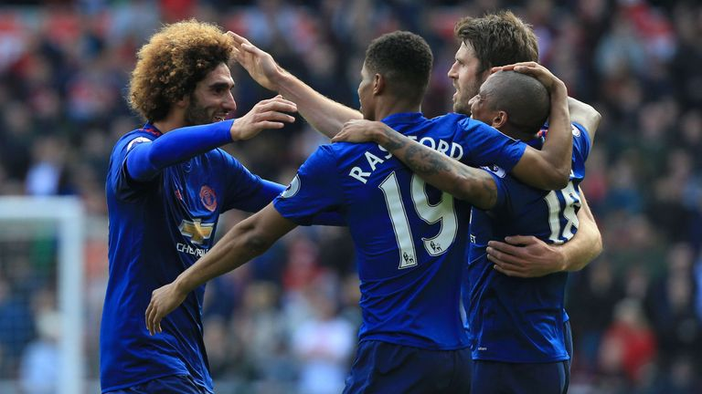 Marouane Fellaini (left) could start against West Brom