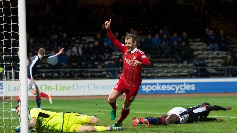 Niall McGinn celebrates after scoring the sixth goal