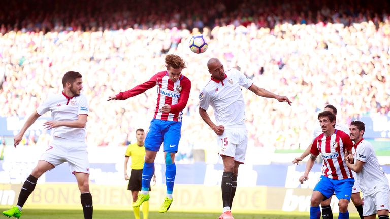 Antoine Griezmann (left) wins the header ahead of Steven N'Zonzi